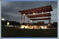 Legacy Park Amphitheater at dusk with lights on before the state